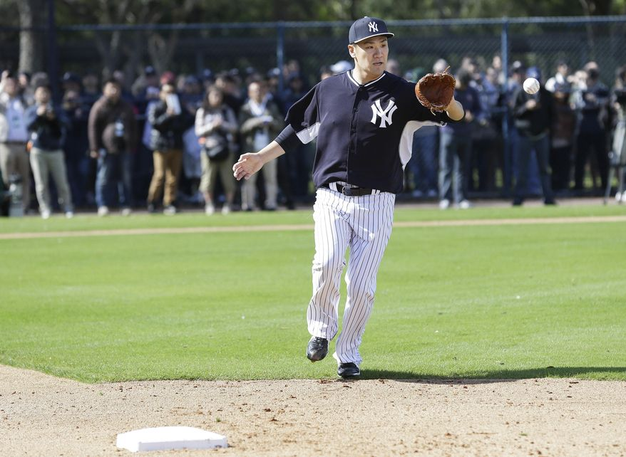 New York Yankees starting pitcher Masahiro Tanaka catches the ball as the covers first base during a drill in a spring training baseball practice Saturday, Feb. 15, 2014, in Tampa, Fla. (AP Photo/Charlie Neibergall)