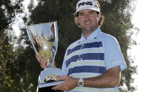 Bubba Watson holds the winner's trophy after victory in the Northern Trust Open golf tournament at Riviera Country Club in the Pacific Palisades area of Los Angeles, Sunday, Feb. 16, 2014. Watson carded a 15-under-par 269, two strokes ahead of the second-place finisher. (AP Photo/Reed Saxon)