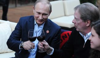 Russian President Vladimir Putin, left, toasts member of the International Olympic Committee Larry Probst while visiting USA House during the 2014 Winter Olympics, Friday, Feb. 14, 2014 in Sochi, Russia.  (AP Photo/RIA-Novosti, Mikhail Klimentyev, Presidential Press Service)