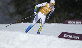 Sweden's Johan Olsson skis during the men's 4x10K cross-country relay at the 2014 Winter Olympics, Sunday, Feb. 16, 2014, in Krasnaya Polyana, Russia. (AP Photo/Gregorio Borgia)