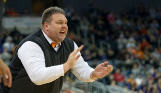 University of Evansville's  head coach Marty Simmons cheers his teem on as he shouts out instruction in the first half of an NCAA college basketball game at the Ford Center in Evansville, Ind., Sunday Feb. 16, 2014. (AP Photo/Daniel R. Patmore)