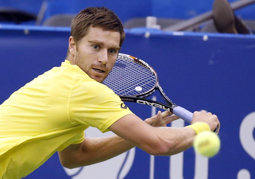 Alex Kuznetsov. of the United States, prepares to hit a return to Lu Yen-Hsun, of Taiwan, in the quarterfinals at the U.S. National Indoor Tennis Championships on Friday, Feb. 14, 2014 in Memphis, Tenn. (AP Photo/Rogelio V. Solis)