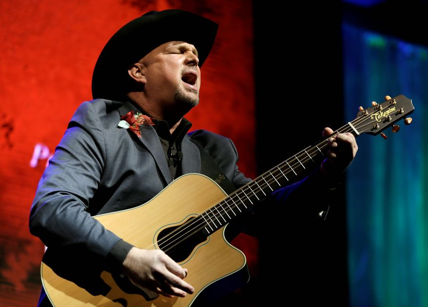 Throughout the 1990s, Garth Brooks ruled country (and a big chunk of rock and pop, for that matter) before pulling a John Lennon and walking away from the industry to spend time with his family. He said he didn't want to miss seeing his three young daughters grow up. (ASSOCIATED PRESS)