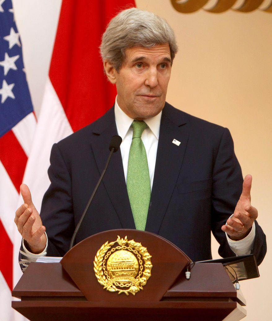 Ahead of the talks, Secretary of State John F. Kerry blasted Iran and Russia for continuing to support the Syrian regime in its 3-year-old civil war, after he arrived Monday in the United Arab Emirates. (Associated Press)