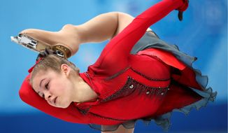 Julia Lipnitskaia of Russia competes in the women's team free skate figure skating competition during the 2014 Winter Olympics. The flexible 15-year-old became the darling of the games, having helped guide Russia to the team gold medal. (Associated Press)