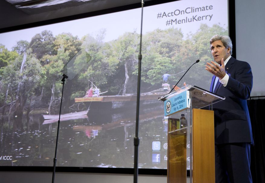 """**FILE** Secretary of State John Kerry gestures during a speech on climate change on Sunday, Feb. 16, 2014, in Jakarta. Kerry called for a """"global solution"""" for climate change in the first of several speeches he will deliver this year on the topic. (Associated Press)"""