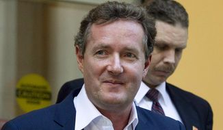 "In this Dec. 20, 2011 file photo, Piers Morgan, host of CNN's ""Piers Morgan Tonight,"" leaves the CNN building in Los Angeles. (AP Photo/Jae C. Hong, File) ** FILE **"