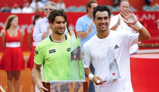 David Ferrer of Spain, left, and Fabio Fognini of Italy, right, pose after the final match of the Buenos Aires' Copa Claro Open in Buenos Aires, Argentina,  Sunday, Feb. 16, 2014. Ferrer won 6-4, 6-3. (AP Photo/Victor R. Caivano)