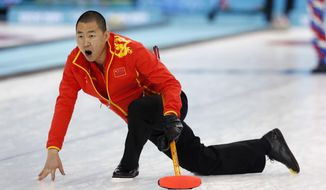 China's skip Liu Rui shouts to his weepers after delivering the rock during men's curling competition against Norway at the 2014 Winter Olympics, Friday, Feb. 14, 2014, in Sochi, Russia. (AP Photo/Robert F. Bukaty)