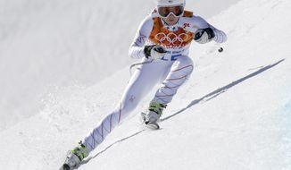 United States' Julia Mancuso makes a turn during the women's downhill at the Sochi 2014 Winter Olympics, Wednesday, Feb. 12, 2014, in Krasnaya Polyana, Russia.(AP Photo/Luca Bruno)
