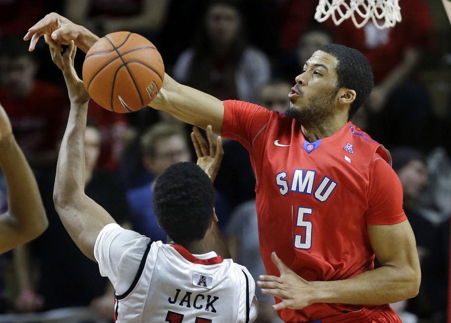 SMU forward Marcus Kennedy (5) blocks a shot by Rutgers forward Kadeem Jack (11) during the first half of an NCAA college basketball game on Friday, Feb. 14, 2014, in Piscataway, N.J. (AP Photo/Mel Evans)