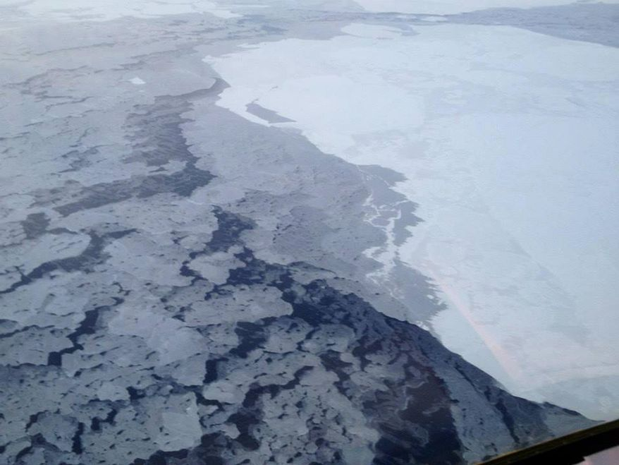 This handout photo provided by The National Oceanic and Atmospheric Administration (NOAA) shows Arctic sea ice in 2013. The Arctic isn't nearly as bright and white as it used to be because of more ice melting in the ocean, and that's turning out to be a global problem, a new study says. With more dark, open water in the summer, less of the sun's heat is reflected back into space. So the entire Earth is absorbing more heat than expected, according to a study published Monday in the Proceedings of the National Academy of Sciences.  (AP Photo/NOAA)