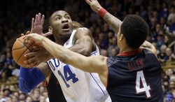 Duke's Rasheed Sulaimon (14) looks to pass as Maryland's Seth Allen (4) and Evan Smotrycz, rear, defend during the first half of an NCAA college basketball game in Durham, N.C., Saturday, Feb. 15, 2014. (AP Photo/Gerry Broome)