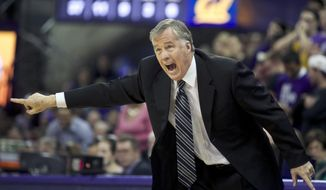 California head coach Mike Montgomery yells during the second half of an NCAA college basketball game against Washington, Saturday, Feb. 15, 2014, in Seattle. California won 72-59. (AP Photo/Stephen Brashear)