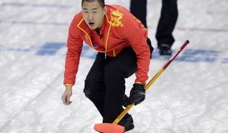 China's skip Liu Rui watches his throw during men's curling competition against Britain at the 2014 Winter Olympics, Monday, Feb. 17, 2014, in Sochi, Russia. (AP Photo/Robert F. Bukaty)