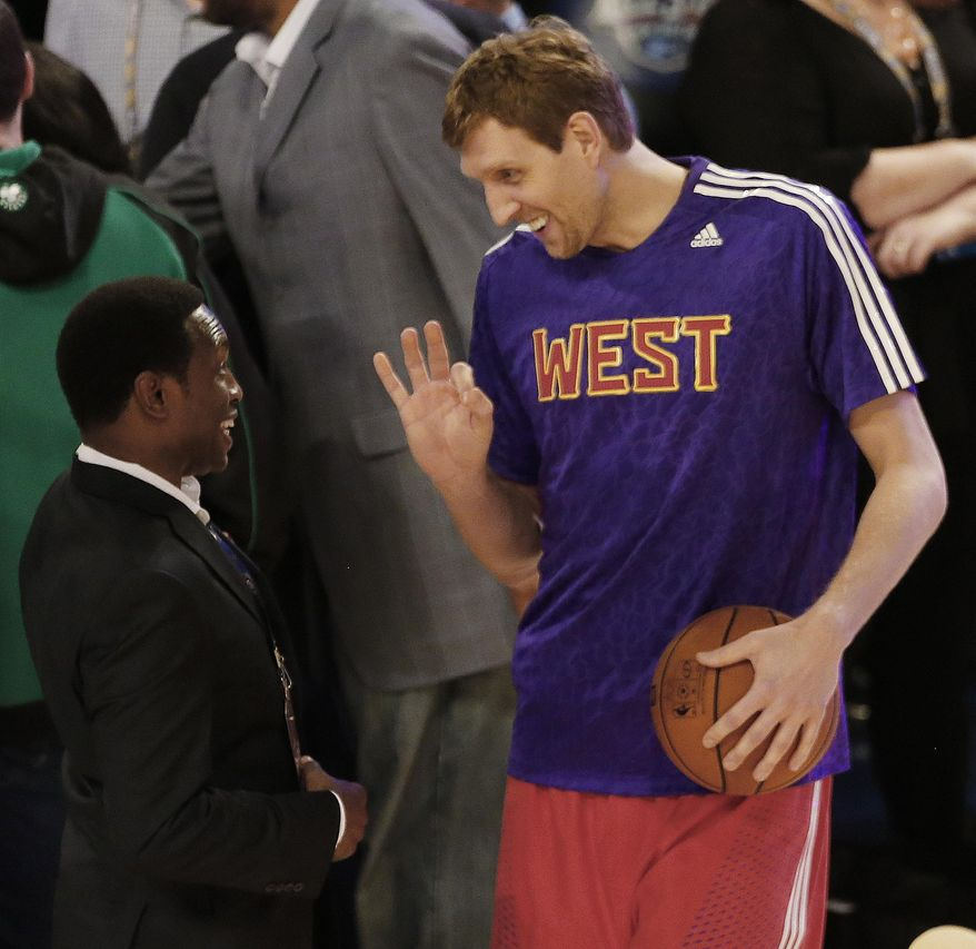Former NBA player Avery Johnson, left speaks with West Team's Dirk Nowitzki, of the Dallas Mavericks (41) before the NBA All Star basketball game, Sunday, Feb. 16, 2014, in New Orleans. (AP Photo/Bill Haber)
