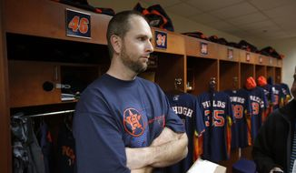 Houston Astros pitcher Scott Feldman talks with the media in front of his locker in the clubhouse before a spring training baseball workout, Saturday, Feb. 15, 2014, in Kissimmee, Fla. (AP Photo/Alex Brandon)