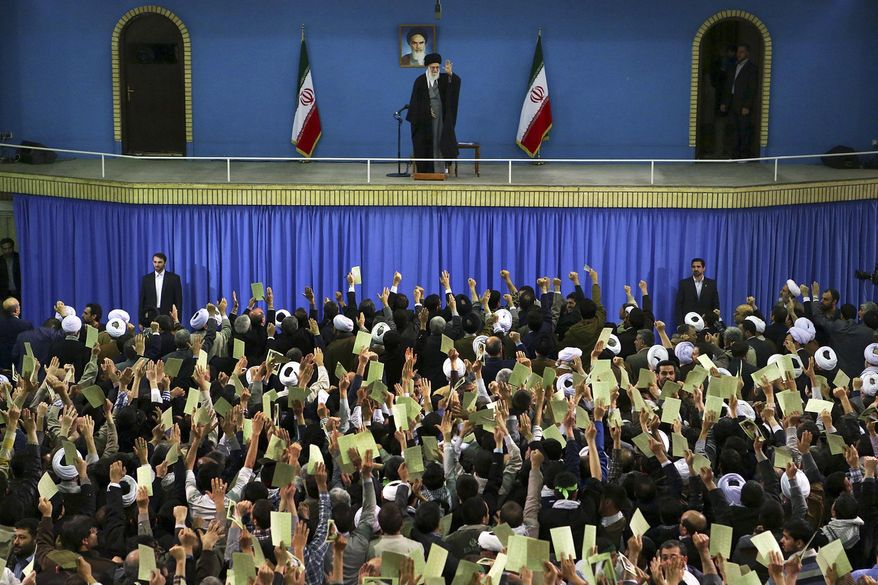 In this picture released by an official website of the office of the Iranian supreme leader, Supreme Leader Ayatollah Ali Khamenei, top center, waves to the crowd prior to his speech, in Tehran, Iran, Monday, Feb. 17, 2014. Iran's top leader backs the continuation of nuclear negotiations with the West but says he doubts they will succeed. (AP Photo/Office of the Iranian Supreme Leader)