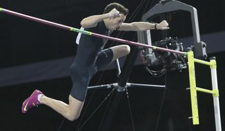 """France's Renaud Lavillenie jumps to clear 6.16 meters, a new world record, at the """"Pole Vault Stars"""" event at Donetsk in eastern Ukraine, Saturday, Feb. 15, 2014. Lavillenie broke Sergei Bubka's 21-year-old indoor pole vault world record. (AP Photo)"""