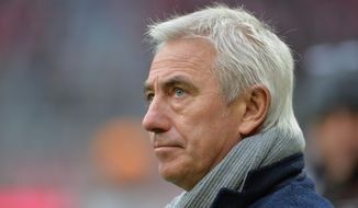 "FILE - In this Dec. 14, 2013 file photo Hamburg head coach Bert van Marwijk waits for the kickoff of the German first division Bundesliga soccer match between FC Bayern Munich and Hamburger SV in Munich, Germany. Hamburger SV sacked Dutch coach van Marwijk on Saturday, Feb. 15, 2014, after the side's seventh consecutive Bundesliga loss, its eighth overall. ""We were forced to make this decision at this time, although we regret it,"" Hamburg sporting director Oliver Kreuzer said. ""We thank Bert van Marwijk for his work."" (AP Photo/Kerstin Joensson, file)"