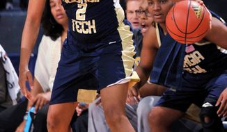 Georgia Tech guard Aaliyah Whiteside drives the lane in the second half of an NCAA college basketball game against Notre Dame, Monday, Feb. 17, 2014, in South Bend, Ind. Notre Dame won 87-72 with Whiteside scoring 21 points. (AP Photo/Joe Raymond)