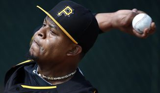 Pittsburgh Pirates pitcher Edinson Volquez throws a bullpen session on the team's first day of baseball spring training for pitchers and catchers, in Bradenton, Fla., Thursday, Feb. 13, 2014. (AP Photo/Gene J. Puskar)