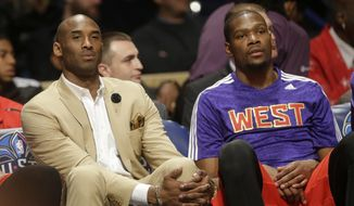 Los Angeles Lakers Kobe Bryant, left, sits with West Team's Kevin Durant, of the Oklahoma City Thunder during the NBA All Star basketball game, Sunday, Feb. 16, 2014, in New Orleans. (AP Photo/Gerald Herbert)