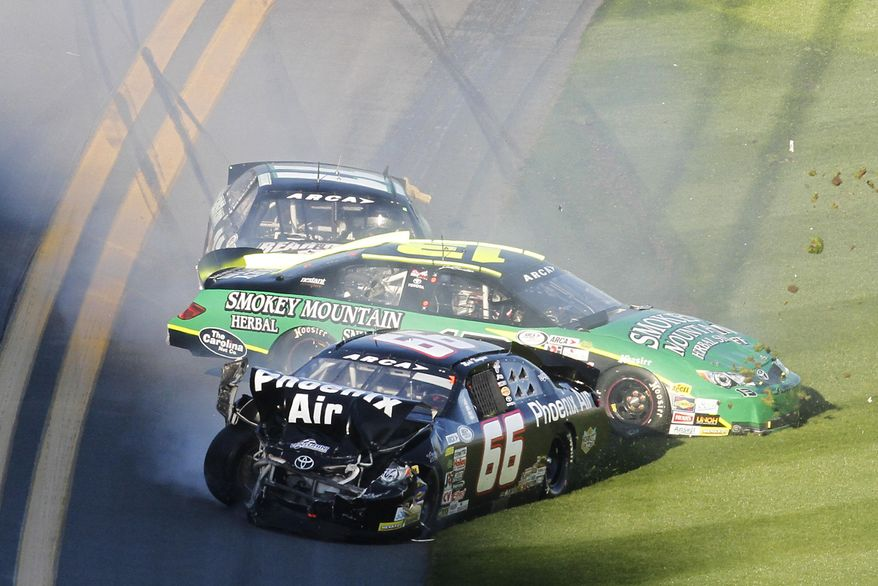 Mark Thompson (66), Jeb Burton (13) and Benny Gordon, back, slide off the track after they were involved in a wreck during the ARCA Series auto race at Daytona International Speedway in Daytona Beach, Fla., Saturday, Feb. 15, 2014. (AP Photo/David Graham)