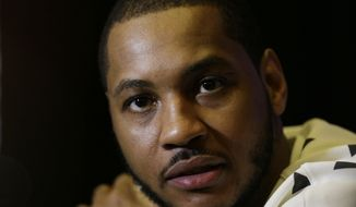 New York Knicks player Carmelo Anthony speaks during the NBA All Star basketball news conference, Friday, Feb. 14, 2014, in New Orleans. The 63rd annual NBA All Star game will be played Sunday in New Orleans. (AP Photo/Gerald Herbert)
