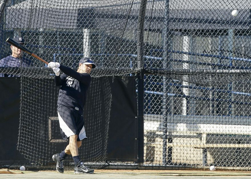 New York Yankees infielder Brian Roberts hits in the batting cage during spring training baseball practice, Monday, Feb. 17, 2014, in Tampa, Fla. (AP Photo/Charlie Neibergall)