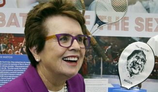 FILE - In this Sept. 5, 2013, file photo, Billie Jean King reflects about her match against Bobby Riggs in 1973 as she stands in front of a display at the U.S. Open tennis tournament in New York. King, who couldn't attend the opening of the Sochi Olympic Games because of her mother's death, will attend the closing ceremony with American speed skaters Bonnie Blair and Eric Heiden on Feb. 23 as part of President Barack Obama's official U.S. delegation. (AP Photo/Darron Cummings, File)