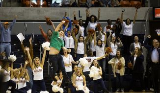 Patrick Burch celebates after winning a Scion car by making a full-court putt during a promotional event at the NCAA college basketball game between Auburn and Mississippi State on Saturday, Feb. 15, 2014, at Auburn Arena in Auburn, Ala. (AP Photo/Opelika-Auburn News, Albert Cesare)