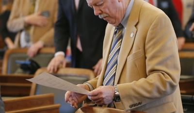 Rep. Ray Merrick, R-Stilwell, and the Speaker of the Kansas House of Representatives looks over papers during Friday's session at the Kansas Statehouse in Topeka, Kan., Friday, Feb. 14, 2014. Senate President Susan Wagle said the bill, which was approved Wednesday in the Kansas House, goes beyond protecting religious freedom. She raised concerns about discrimination and how it could impact businesses that would refuse services to gay couples. (AP Photo/Orlin Wagner)