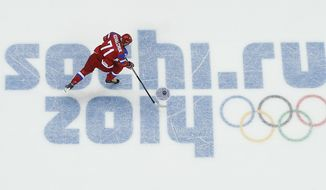 Russia forward Ilya Kovalchuk takes the puck to the goal during a shootout against Slovakia in overtime of a men's ice hockey game at the 2014 Winter Olympics, Sunday, Feb. 16, 2014, in Sochi, Russia. Kovalchuck scored the winning goal to give Russia the 1-0 win. (AP Photo/Julio Cortez )