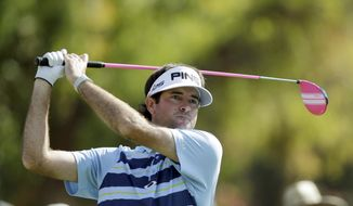 Bubba Watson drives on the second tee at the final round of the Northern Trust Open golf tournament at Riviera Country Club in the Pacific Palisades area of Los Angeles, Sunday, Feb. 16, 2014.  (AP Photo/Reed Saxon)