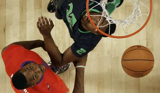 West Team Dwight Howard, of the Houston Rockets (12) and East Team John Wall, of the Washington Wizards (2) vie for a loose ball during the NBA All Star basketball game, Sunday, Feb. 16, 2014, in New Orleans. (AP Photo/Gerald Herbert)