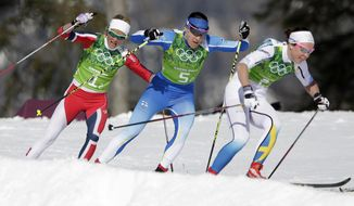 Norway's Therese Johaug, Finland's Aino-Kaisa Saarinen, and Sweden's Emma Wiken, from left, take a curve during the women's 4x5K cross-country relay at the 2014 Winter Olympics, Saturday, Feb. 15, 2014, in Krasnaya Polyana, Russia. (AP Photo/Matthias Schrader)