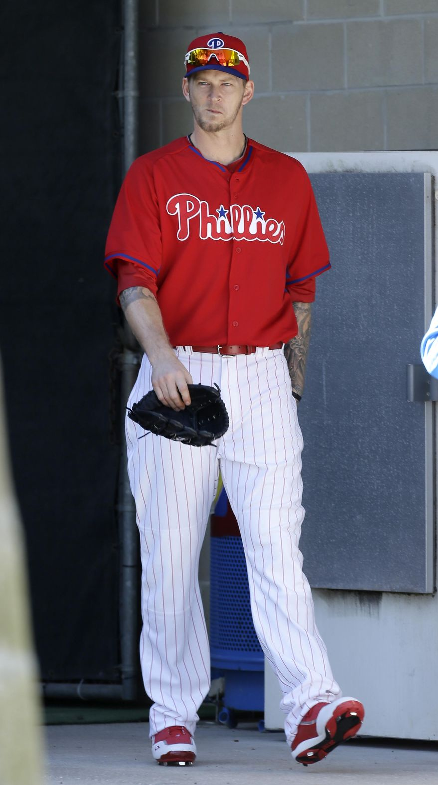 Philadelphia Phillies pitcher A.J. Burnett walks to the field before a spring training baseball practice Sunday, Feb. 16, 2014, in Clearwater, Fla. (AP Photo/Charlie Neibergall)