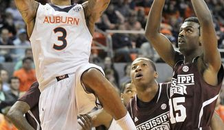 Auburn guard Chris Denson (3) scores against Mississippi State during an NCAA college basketball game Saturday, Feb. 15, 2014, at Auburn Arena in Auburn, Ala. (AP Photo/AL.com, Julie Bennett) MAGS OUT