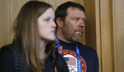 """U.S. Alpine director Patrick Riml looks on from the side as U.S. skier Mikaela Shiffrin speaks during a US ski team press conference at the Gorki media centre at the Sochi 2014 Winter Olympics, Saturday, Feb. 15, 2014, in Krasnaya Polyana, Russia. Midway through the 10-event Alpine schedule, the Americans have won only one of the 15 medals awarded, Julia Mancuso's bronze in the super-combined.  """"We probably expected a little more, to be honest,""""  Riml said Saturday, when only two of four American competitors completed the super-G race.  (AP Photo/Christophe Ena)"""