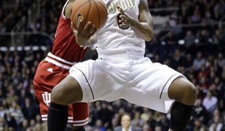 Purdue guard Terone Johnson, front, shoots in front of Indiana guard Yogi Ferrell in the first half of an NCAA college basketball game in West Lafayette, Ind., Saturday, Feb. 15, 2014. (AP Photo/Michael Conroy)