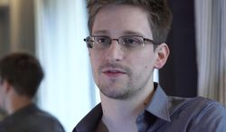 In this June 9, 2013, photo provided by The Guardian Newspaper in London, former NSA contractor Edward Snowden is shown. (AP Photo/The Guardian, Glenn Greenwald and Laura Poitras, File)