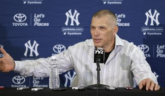 New York Yankees manager Joe Girardi speaks during a news conference following practice at baseball spring training, Friday, Feb. 14, 2014, in Tampa, Fla. (AP Photo/Charlie Neibergall)