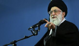 In this picture released by an official website of the office of the Iranian supreme leader, Supreme Leader Ayatollah Ali Khamenei delivers a speech, in Tehran, Iran, Monday, Feb. 17, 2014. Iran's top leader backs the continuation of nuclear negotiations with the West but says he doubts they will succeed. (AP Photo/Office of the Iranian Supreme Leader)