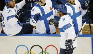 Finland forward Teemu Selanne (8) is congratulated by his teammates after scoring a goal against Norway during the 2014 Winter Olympics men's ice hockey game at Shayba Arena, Friday, Feb. 14, 2014, in Sochi, Russia. (AP Photo/Petr David Josek)