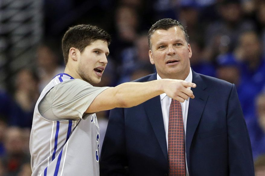 Creighton's Doug McDermott, left, points as he stands next to his father Creighton coach Greg McDermott, in the first half of an NCAA college basketball game against Villanova in Omaha, Neb., Sunday, Feb. 16, 2014. (AP Photo/Nati Harnik)