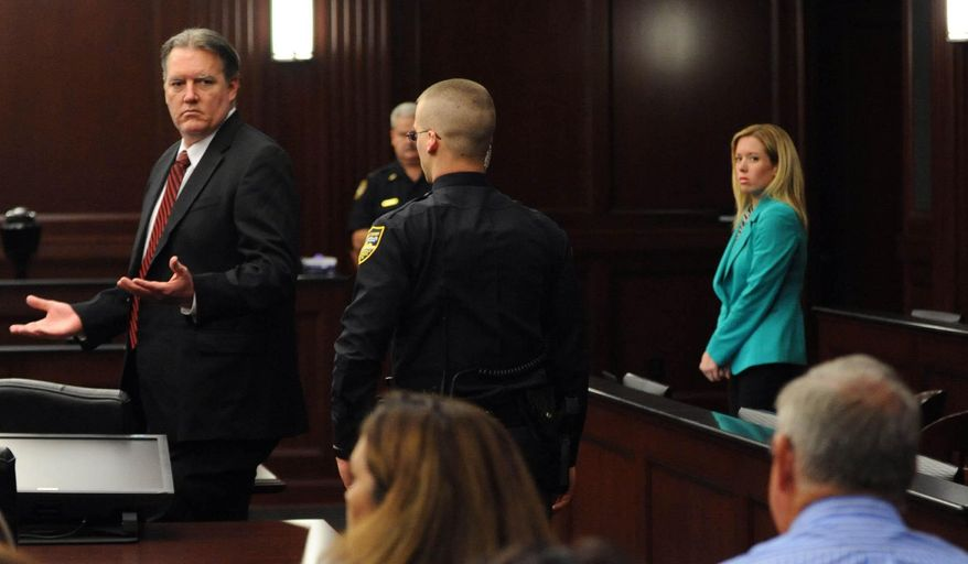 Michael Dunn reacts after the verdict is read in Jacksonville, Fla., Saturday, Feb. 15, 2014. Dunn was convicted of attempted murder in the shooting death of a teenager over an argument over loud music, but jurors could not agree on the most serious charge of first-degree murder. (The Florida Times-Union, Bob Mack, Pool)