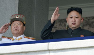 **FILE** In this photo taken on April 15, 2012, North Korean leader Kim Jong Un, right, and Vice Marshal Choe Ryong Hae salute during a mass military parade in Kim Il Sung Square to celebrate the centenary of the birth of his grandfather, national founder Kim Il Sung in Pyongyang, North Korea. (AP Photo/Kyodo News)