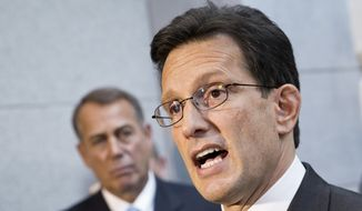 **FILE** House Majority Leader Eric Cantor, R-Va., with House GOP leaders, speaks with reporters following a Republican strategy session, at the Capitol in Washington, Tuesday, Oct. 15, 2013. At left is Speaker of the House John Boehner, R-Ohio.  (AP Photo/J. Scott Applewhite)