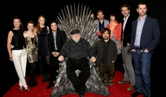 """HOLLYWOOD, CA - MARCH 19: (L-R) Michelle Fairley, Maisie Williams, Sophie Turner, Kit Haringston, George R.R. Martin, Peter Dinklage, Nikolaj Coster-Waldau, Lena Heady, David Benioff and D. B. Weiss pose for a portrait at the Academy of Television Arts & Sciences Presents An Evening With """"Game of Thrones"""" at the TCL Chinese Theater on March 19, 2013 in Hollywood, California. (Photo by Brian Dowling/Invision for the Academy of Television Arts & Sciences/AP Images)"""